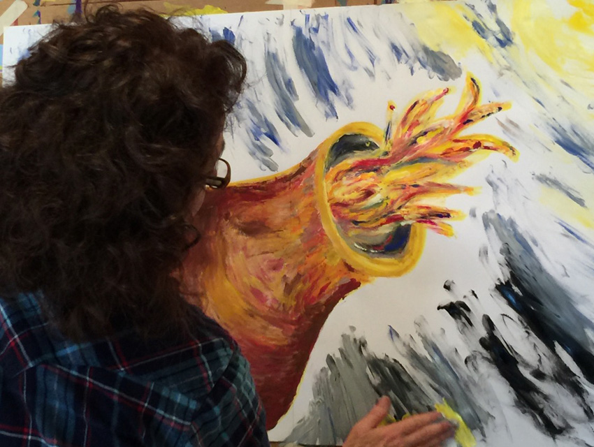 A woman participating in a Painting Experience workshop on Whidbey Island