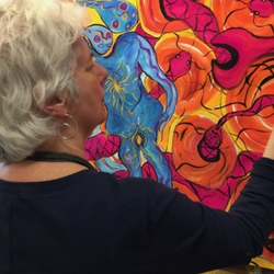 A process painter working on a brightly colored painting in the San Rafael studio.