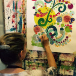 Photo of woman painting swirls and dots (Episode 11 of The Painting Experience Podcast: Abstract vs. Figurative Painting)