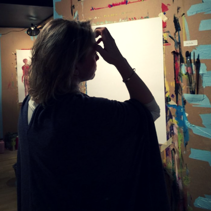 A painter standing before a blank piece of paper