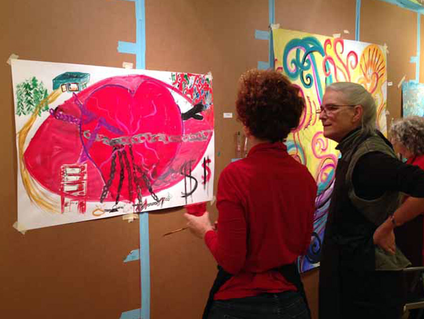 Photo of Lydia Marshall talking with a process painter at Great Vow Zen Center