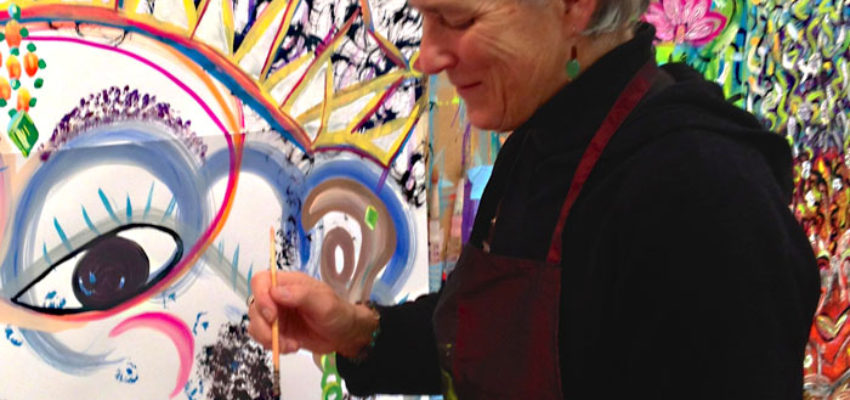 Photo of Lydia painting at a Painting Experience workshop held on Whidbey Island