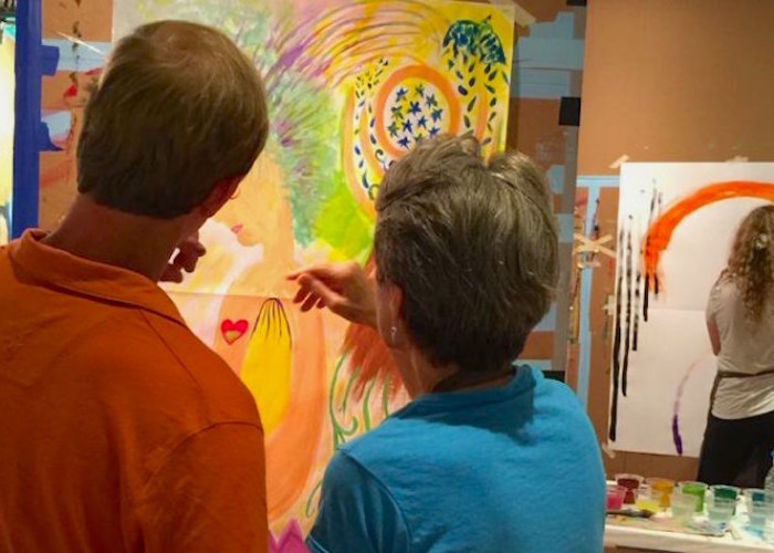 Photo of a painter and facilitator at a Painting Experience Workshop (Ocala, Florida)