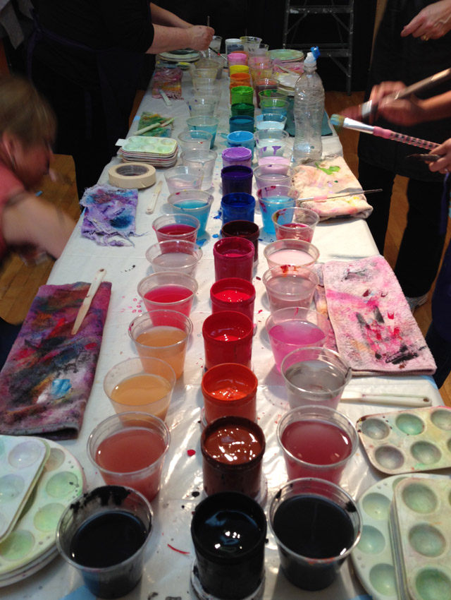 Photo of a colorful paint table at a Painting Experience workshop